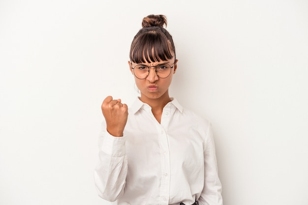 Young mixed race business woman isolated on white background  showing fist to camera, aggressive facial expression.