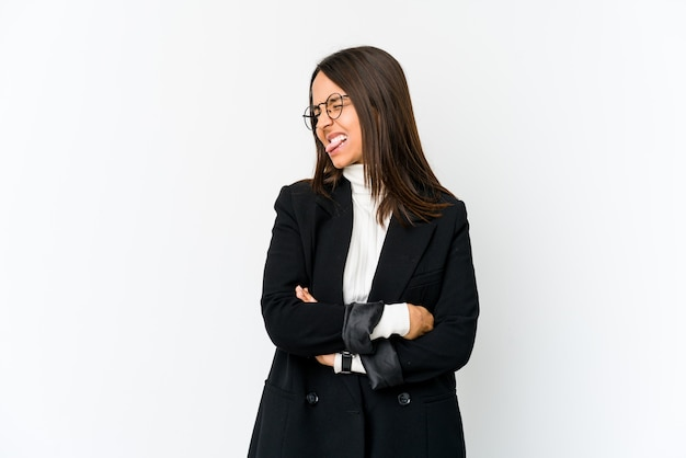 Young mixed race business woman isolated on white funny and friendly sticking out tongue.