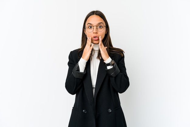 Young mixed race business woman isolated on white shocked, covering mouth with hands, anxious to discover something new.