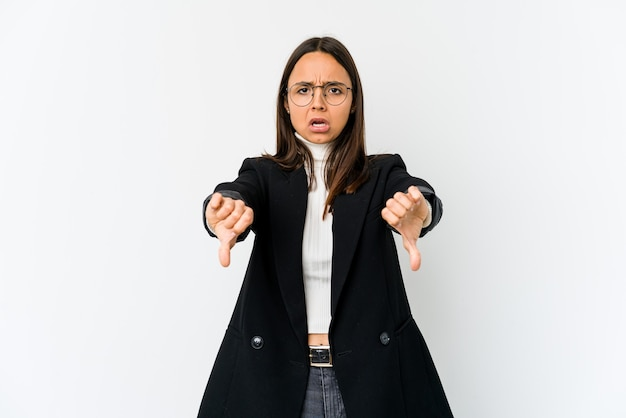 Young mixed race business woman isolated on white space showing thumb down and expressing dislike.