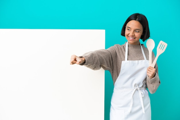 Young mixed race cook woman with a big placard isolated