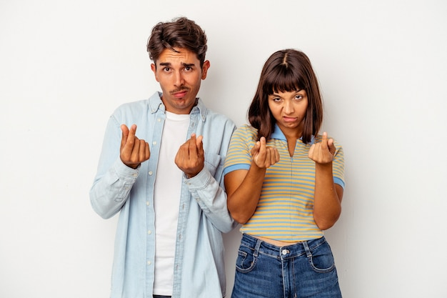 Young mixed race couple isolated on white background showing that she has no money.