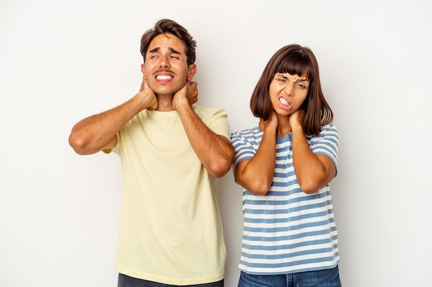 Young mixed race couple isolated on white background suffering neck pain due to sedentary lifestyle.