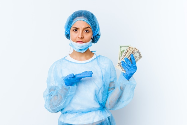 Young mixed race doctor woman holding dollars isolated on white background