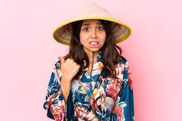 Young mixed race hispanic woman isolated shocked pointing with index fingers to a copy space.