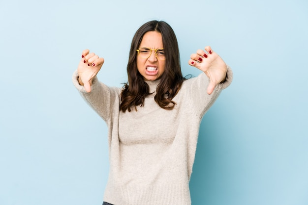 Young mixed race hispanic woman isolated showing thumb down and expressing dislike.