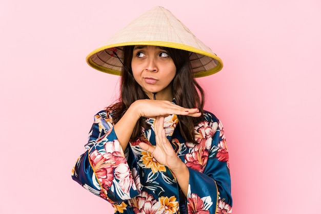Young mixed race hispanic woman isolated showing a timeout gesture.