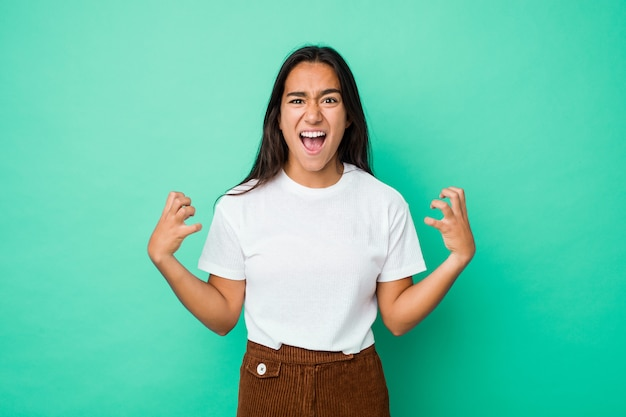 Young mixed race indian woman isolated screaming with rage.