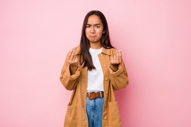 Young mixed race indian woman isolated showing that she has no money.