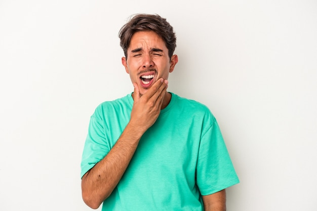 Young mixed race man isolated on white background having a strong teeth pain, molar ache.