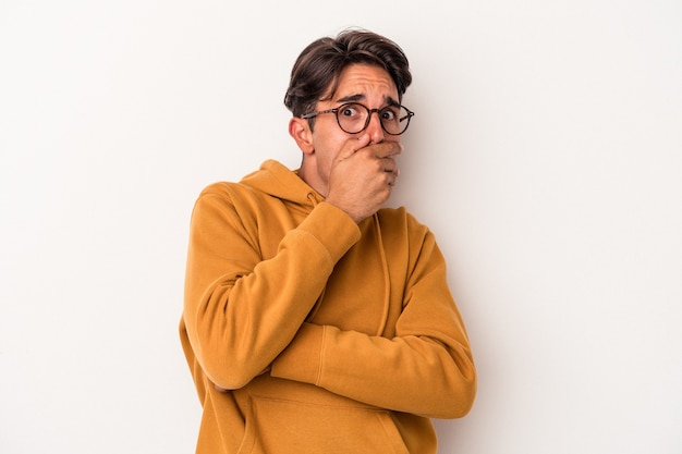 Young mixed race man isolated on white background scared and afraid.