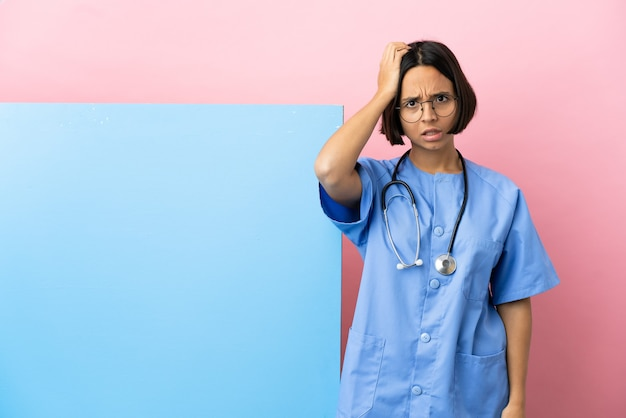 Young mixed race surgeon woman with a big banner over isolated background with an expression of frustration and not understanding