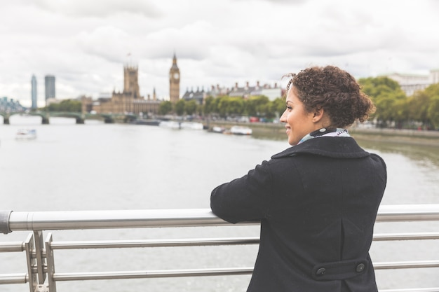 Young mixed race woman on a bridge in london