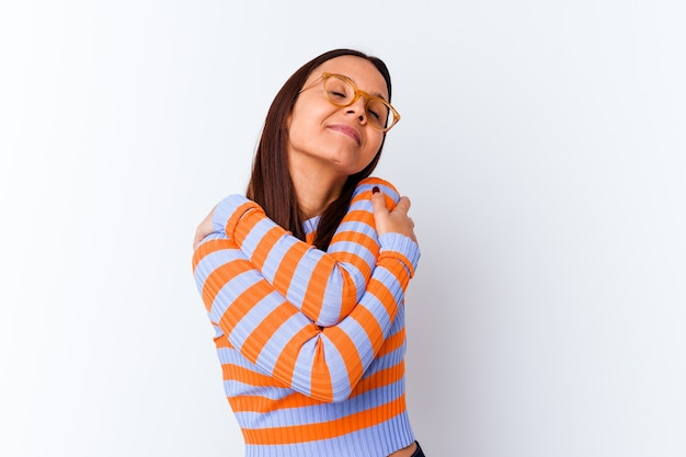 Young mixed race woman isolated hugs, smiling carefree and happy.