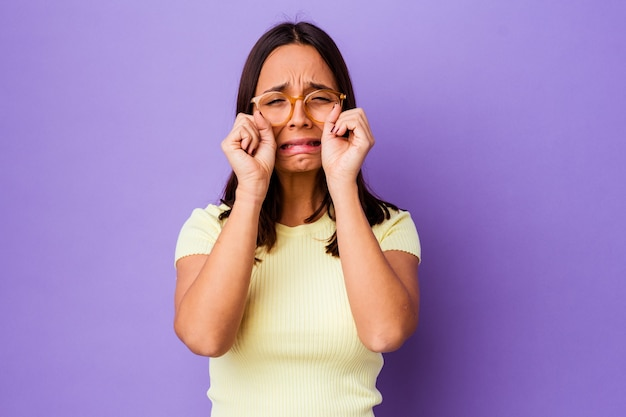 Young mixed race woman isolated whining and crying disconsolately.