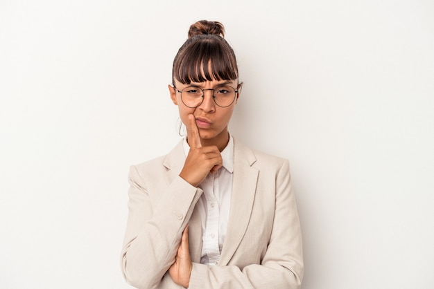 Young mixed race woman isolated on white background  contemplating, planning a strategy, thinking about the way of a business.