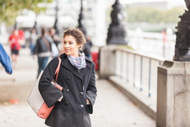 Young mixed race woman walking in london