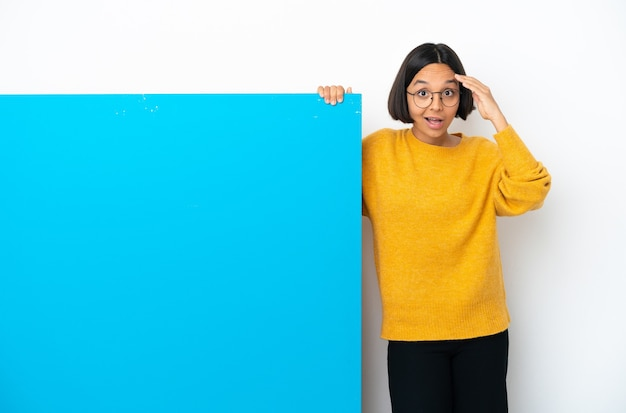 Young mixed race woman with a big blue placard isolated has realized something and intending the solution