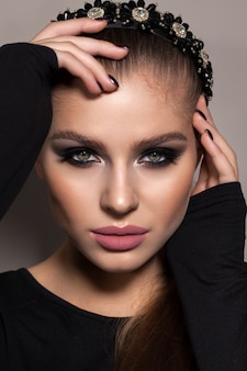Young model with professional smoky eyes make up