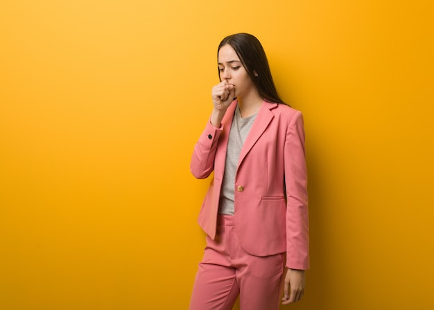 Young modern business woman coughing, sick due a virus or infection