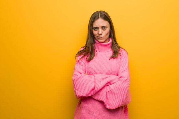Young modern woman crossing arms relaxed