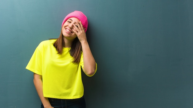 Young modern woman embarrassed and laughing at the same time