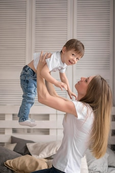 Young mom playing with son