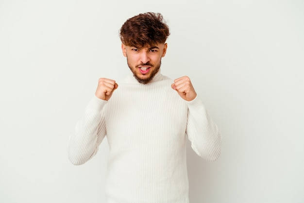 Young moroccan man isolated on white upset screaming with tense hands.