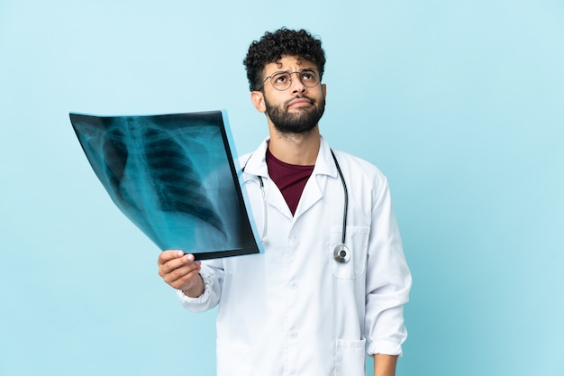 Young moroccan traumatologist in workplace isolated