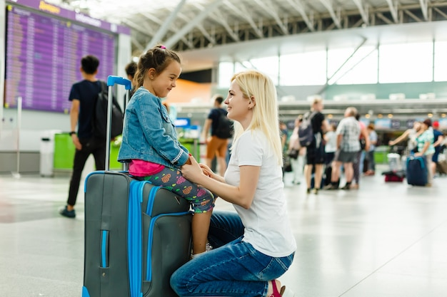 Young mother and child in the airport.