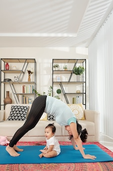 Young mother exercising at home