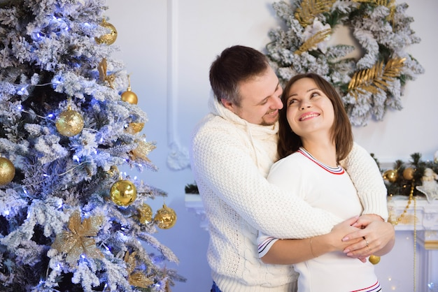 Young mother and father celebrating christmas at home.