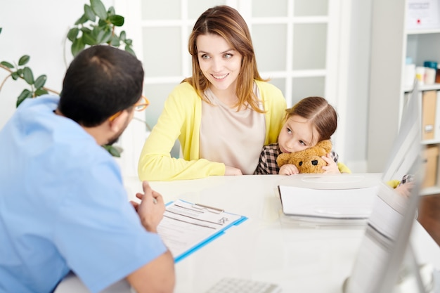 Young mother visiting modern clinic