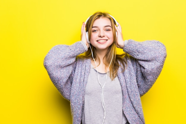 Young motion teen girl with headphones listening music. music teenager girl dancing