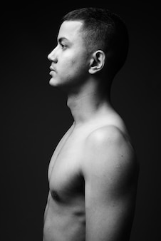 Young multi-ethnic asian man shirtless in black and white