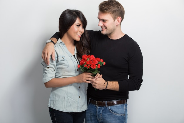 Young multicultural couple celebrating event