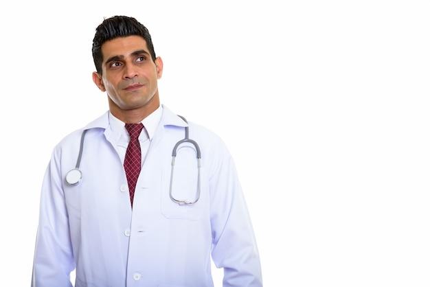 若い筋肉のペルシャ人男性医師思考