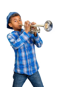 Young musician plays the solo on trumpet .
