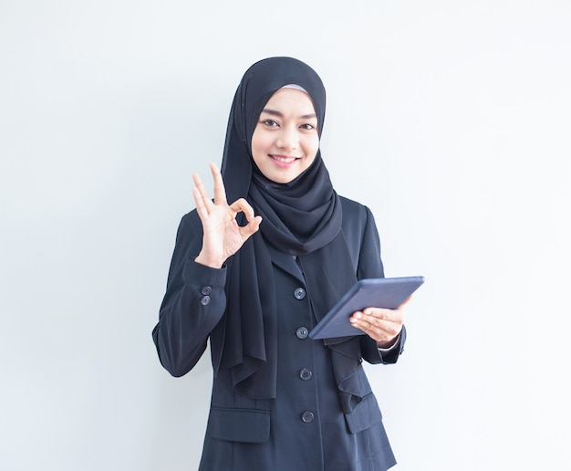 Young muslim business woman holding tablet