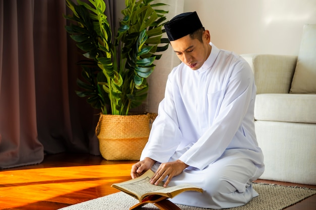 Young muslim man making traditional prayer to allah