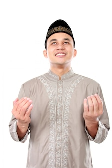 Young muslim man praying to god