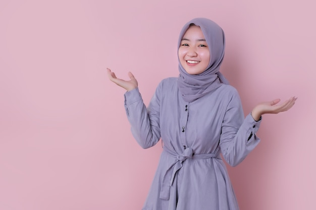 Young muslim woman wearing a blue hijab