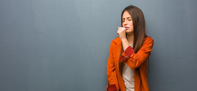 Young natural woman coughing, sick due a virus or infection