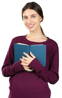 Young nice woman reading a blue book isolated on white