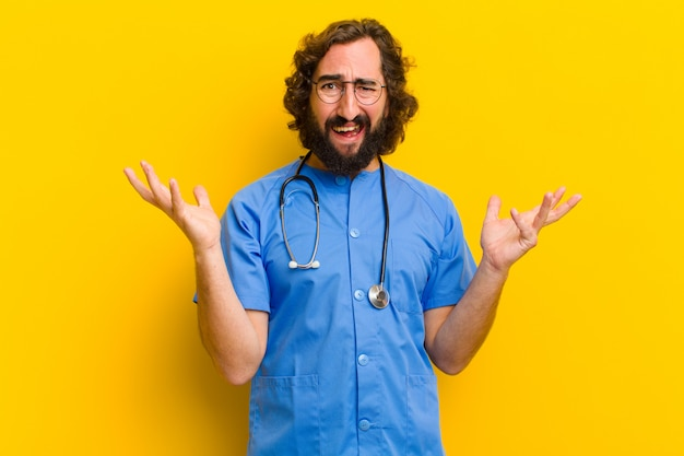 Young nurse man angry or disagree concept
