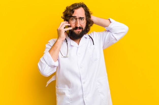 Young nurse man calling with a mobile phone