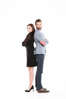 Young offended loving couple standing isolated
