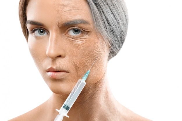 Young and old face comparison. woman with syringe.