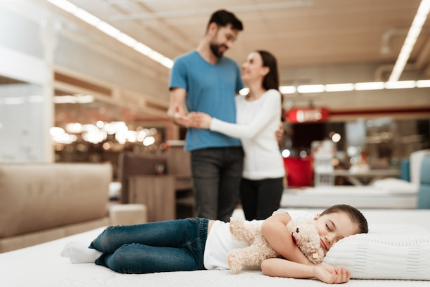 Young parents looking at little girl sleeping