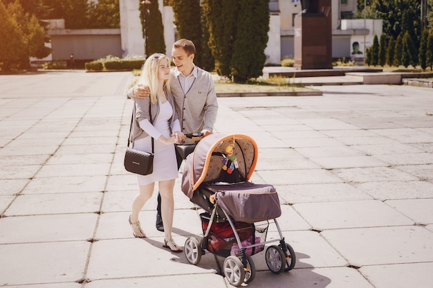 Young parents walking with their baby